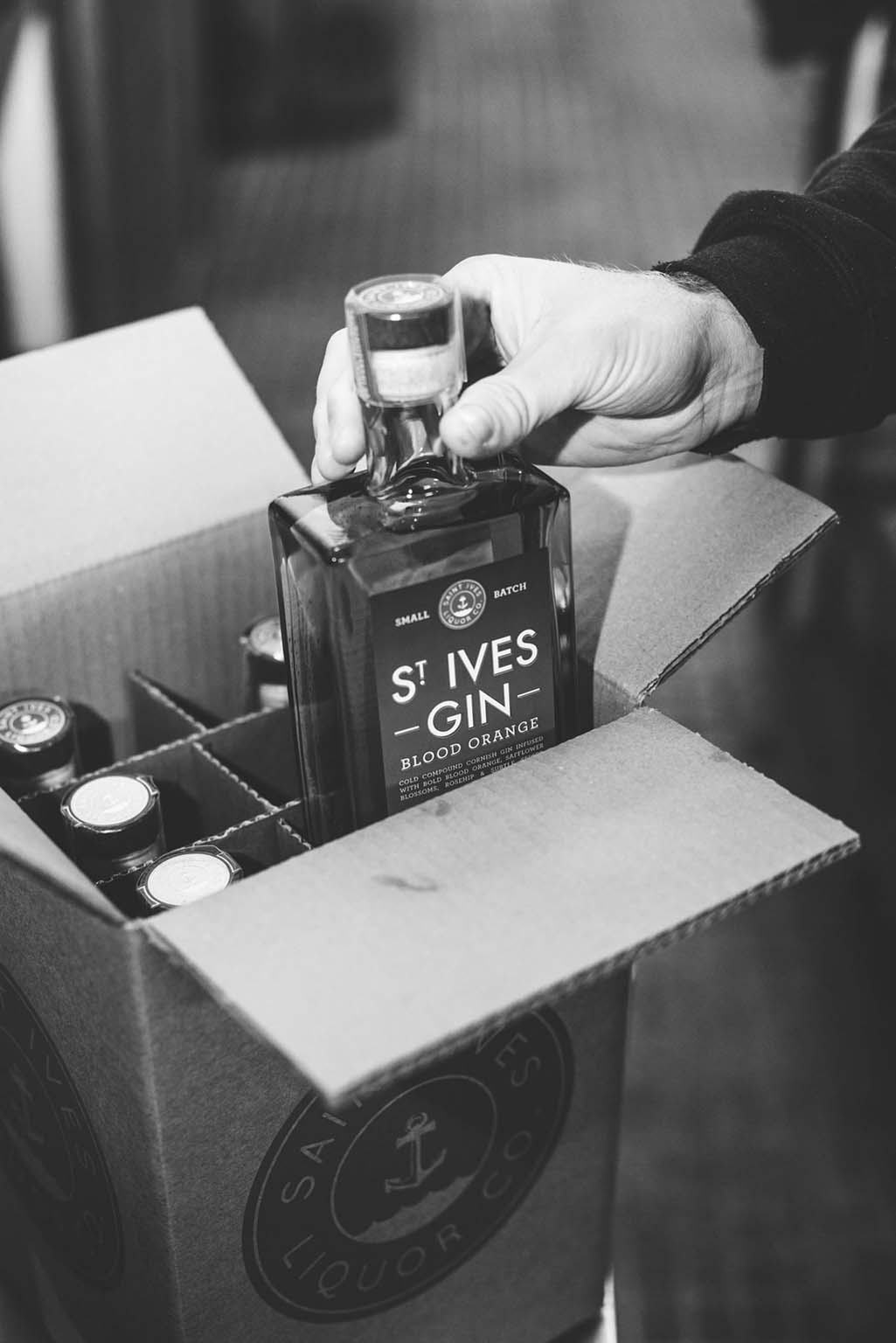 St Ives Blood Orange being packed in black and white