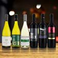 Everyday Wines on a Wooden table with dark bokeh background