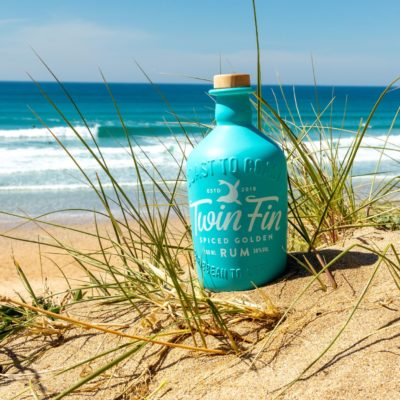 Twin Fin Spiced Rum on the beach