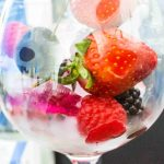 Glass with ice and fruitt close up