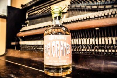 Bad Fagin's Big Orange Gin on a closed piano