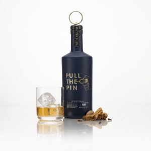 Pull The Pin Spiced Rum with glass