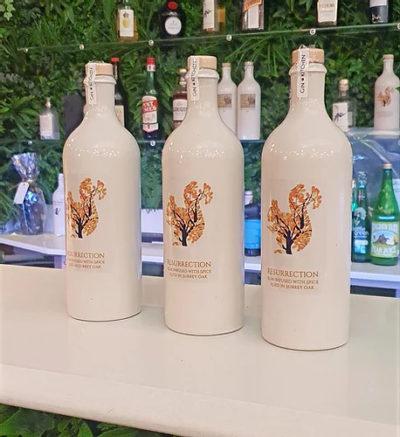 Resurrection-Rum 3 bottles on bar