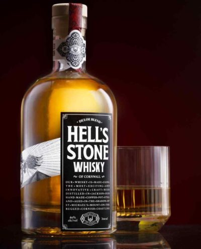 Hell's Stone whisky bottle with glass