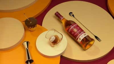 The Lasanta lying on a table with a whisky glass and a spoon