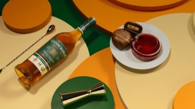 The Quinta Ruban on a table with honey and jigger